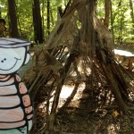 a fort or a teepee built with branches, in the play area at the Garden in the Woods in Framingham, MA
