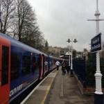 platform at the Windsor & Eton Riverside station, with the Windsor Castle in the distance