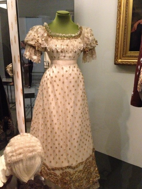 1820s ball gown of silk satin and silk net embroidered with metal and trimmed with silk blonde bobbin lace