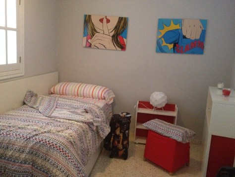one of the bedrooms in Apartamentos en Mérida