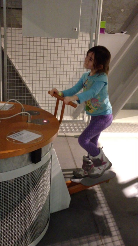 "making electricity with a ""stair master"" at the Copernicus Science Centre in Warsaw, Poland"