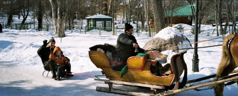 Dziadek (Grandfather) and Wnuczek (grandson) having fun on the sled being pulled by the sleigh in Rabka, Poland, in 2006