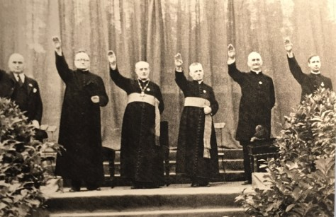 Catholic dignitaries at a youth meeting in Berlin-Neukölln, August 20, 1933, with their arms raised in Nazi salute