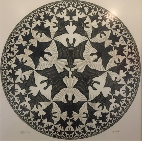 "M.C. Escher's 1960 woodcut in black and ochre, printed from two blocks, ""Circle limit IV (Heaven and Hell)"