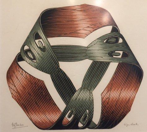 "M.C. Escher's 1961 wood engraving and woodcut in red, green, gold and blac, printed from four blocks, ""Möbius strip I"""