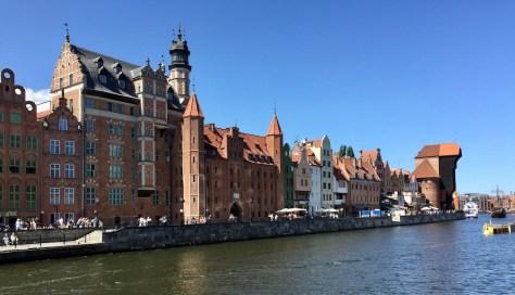 view on Długie Pobrzeże (Long Strand) with Brama Żuraw (waterfront crane gate) in Gdańsk, Poland
