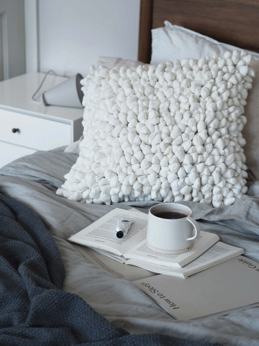 Sustainable cushions and home accessories from Happy + Co - Scandinavian bedroom - grey bed linen - monochrome