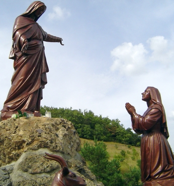 statues depicting the apparition of Notre-Dame du Laus to Benoite Rencurel; date and artist unknown; photographed on 24 August 2009 by moi-même; swiped from Wikimedia Commons; click for source image