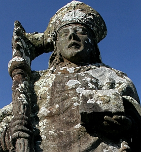 detail of a statue of Saint Budoc, sculptor unknown; photo taken on 15 February 2009 in Trégarvan, Brittany, France by Freh Dhennin; swiped from his flickr.com feed