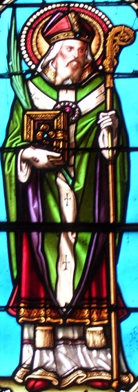 detail of a stained glass window of Saint Clarus of Aquitaine, date unknown, artist unknown; church of Saint-Paul-en-Born, Landes, France; photographed by Jibi44; swiped from Wikimedia Commons