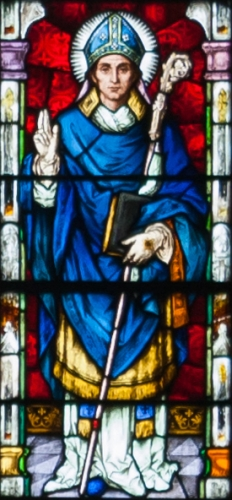 detail of a stained glass window depicting Saint Mura of Fahan, created c.1900 by Meyer and Co; Cathedral of Saint Eugene, Derry, Northern Ireland; photographed on 17 September 2013 by Andreas F Borchert; swiped from Wikimedia Commons; click for source image
