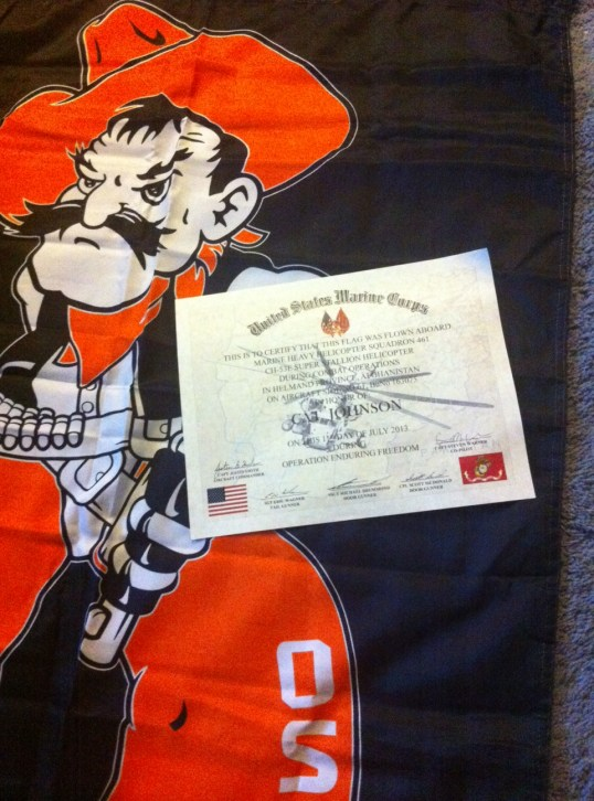 The flag & certificate signed by the crew -Aircraft Commander, Co-pilot, Tail Gunner and 2 Door Gunners.
