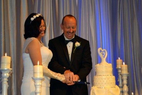 Couple cutting wedding cake at Cavender Castle Ballroom