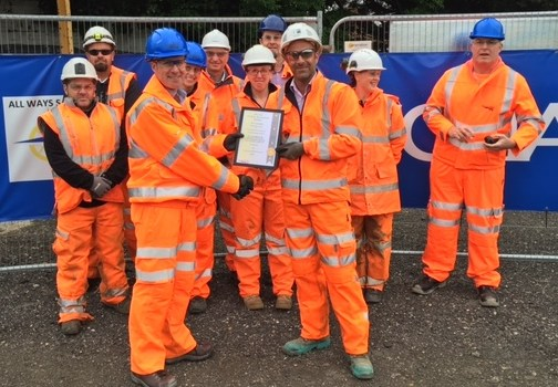 Buckingham Site Manager, Jamie Gulliver (Front right) and CC Ground Investigation Contract Manager, Kelly Spear (Centre - white hat), receiving the award from Network Rail's Senior Project Manager, Anthony Bolton (Front left)