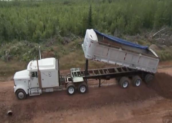 Video: Dump Truck Rolls Over