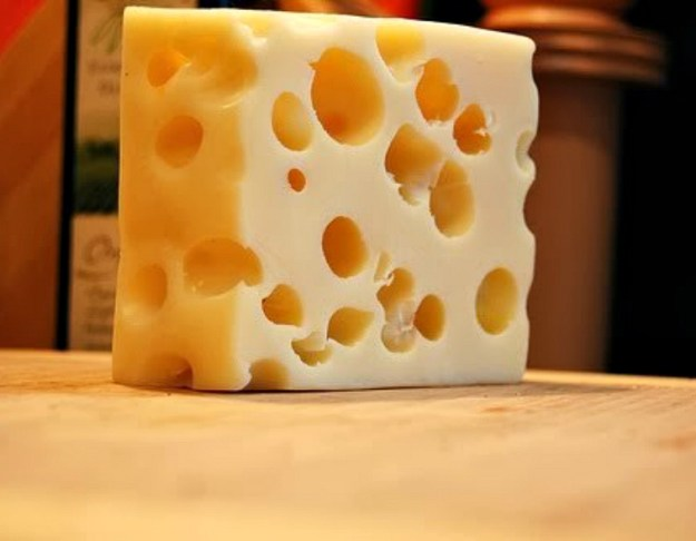 why does swiss cheese have holes in it