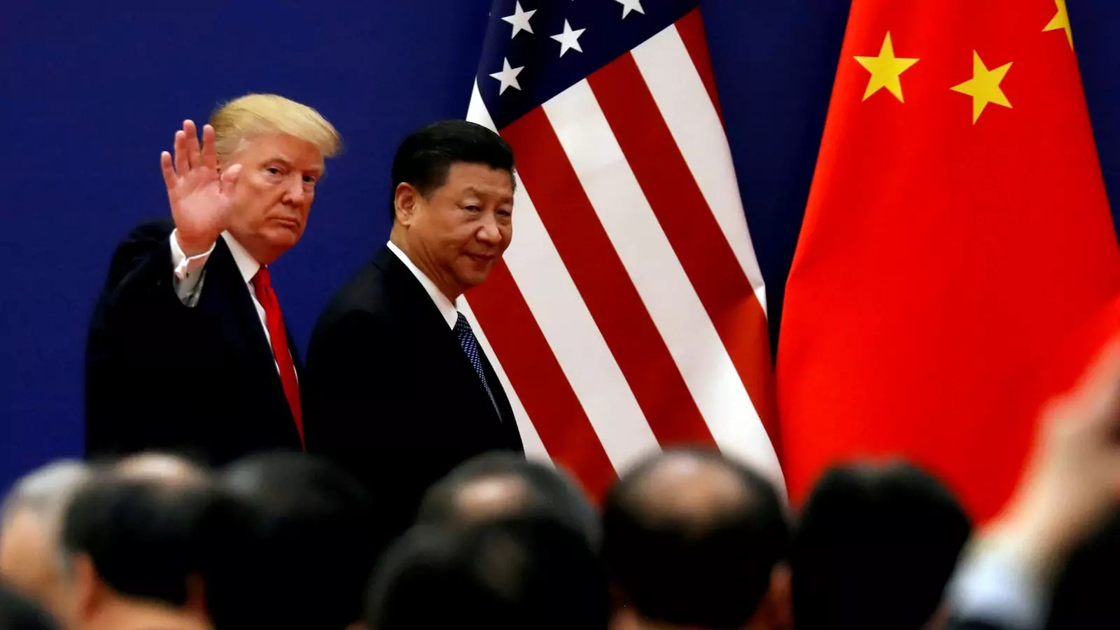 U.S. President Donald J. Trump and China's President Xi Jinping meet business leaders at the Great Hall of the People in Beijing, China, on November 9, 2017.