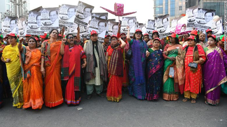 Supporters of the Bangladesh Awami League shout slogans while taking part in a rally ahead of December 30 general election vote, in Dhaka on December 27, 2018.