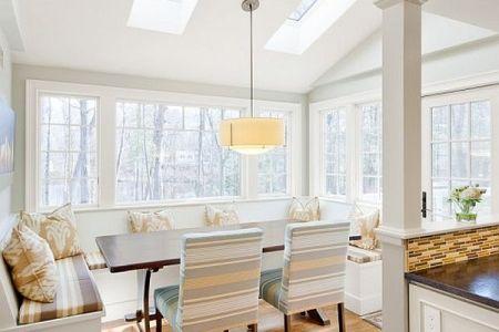 white kitchen design with fancy breakfast nook