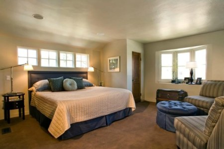 a comfy guest room with seating