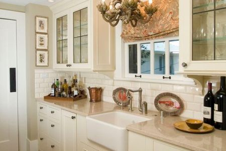 traditional kitchen design with lovely lighting and cly cabinets