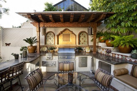 mediterranean style outdoor space with a beautiful kitchen