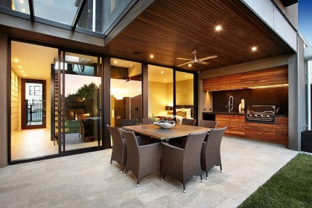 structure of the house offers shade to the outdoor kitchen