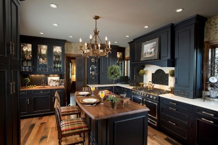 black brings modern refinement to a traditional kitchen