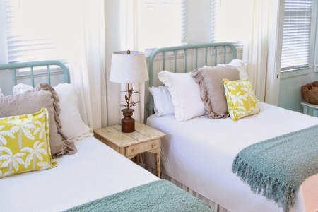 bright and beach themed twin beds in a guest room