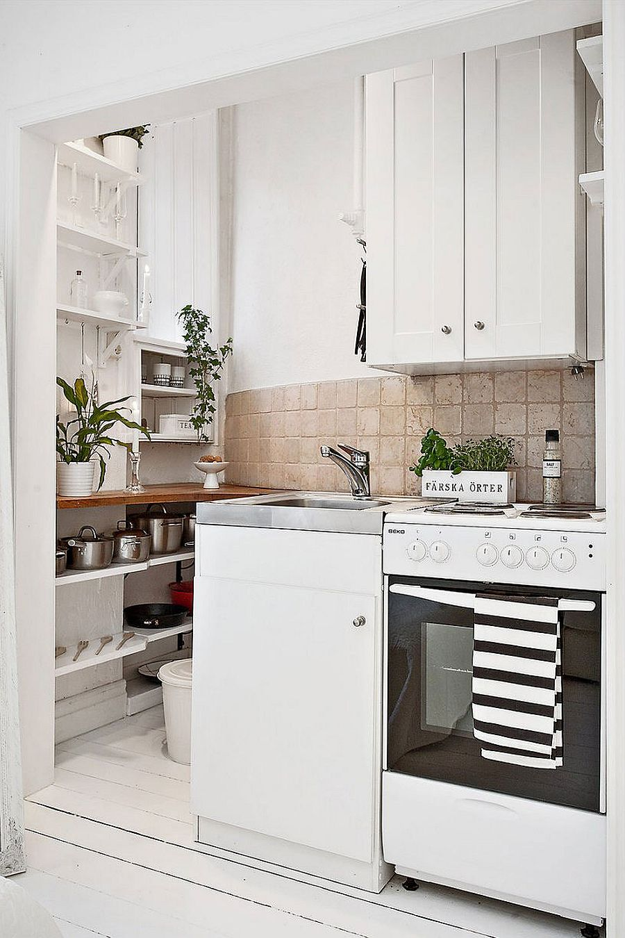 Lovely Tiny Nook Inside Scandinavian Apartment Turned Into Space Savvy Kitchen Tiny Apartment Kitchen Tables Tiny Studio Apartment Kitchens apartment Tiny Apartment Kitchens