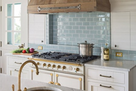 barn board kitchen hood turquoise blue subway tiles white french stove
