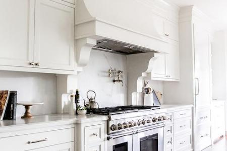 white french range hood with corbels