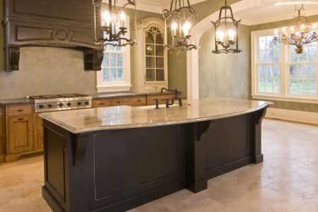 custom wood kitchen island with granite slab counter