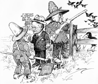 A political cartoon showing President Herbert Hoover explaining his farm relief program to a farmer. The relief program is shown as a straw scarecrow scaring off hard times depicted as birds. (Credit: MPI/Getty Images)