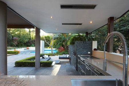 outdoor living with sunken lounge kitchen food preparation area with views of the garden