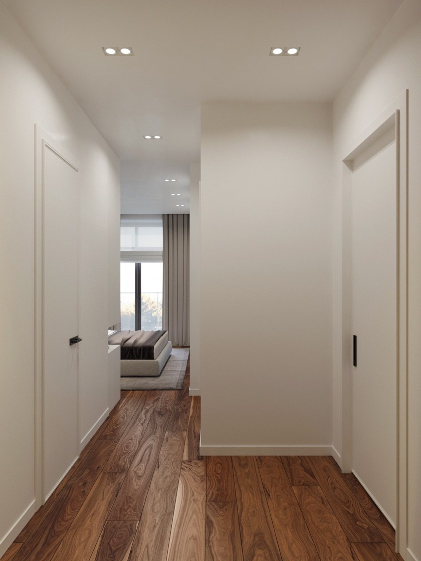 Wooden walls, floors and details act as the hero, creating cohesion between spaces and warmth wherever they lead. Corridors and walk-in wardrobes clothed in top-to-toe wood stand framed by white walls.