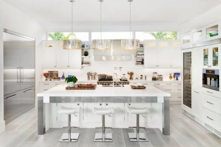all white and stainless steel kitchen grey wood floors