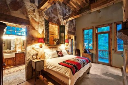 master rustic bedroom rocks exposed