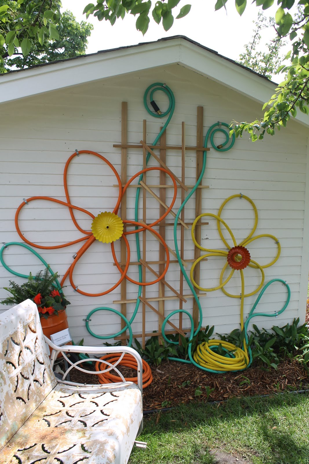 Outstanding Make Flowers From Hoses Outdoor House Decor How To Beautify Your House Outdoor Wall Dcor Ideas Backyard Fence Clipart Backyard Fence Art Ideas outdoor Backyard Fence Art