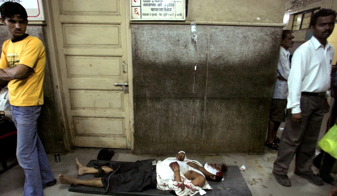 A victim of a train blast lies on the floor of a hospital in Mumbai in 2006. More than 100 people were killed in seven bomb explosions at rail stations and on trains in India's financial hub. Photo: Reuters