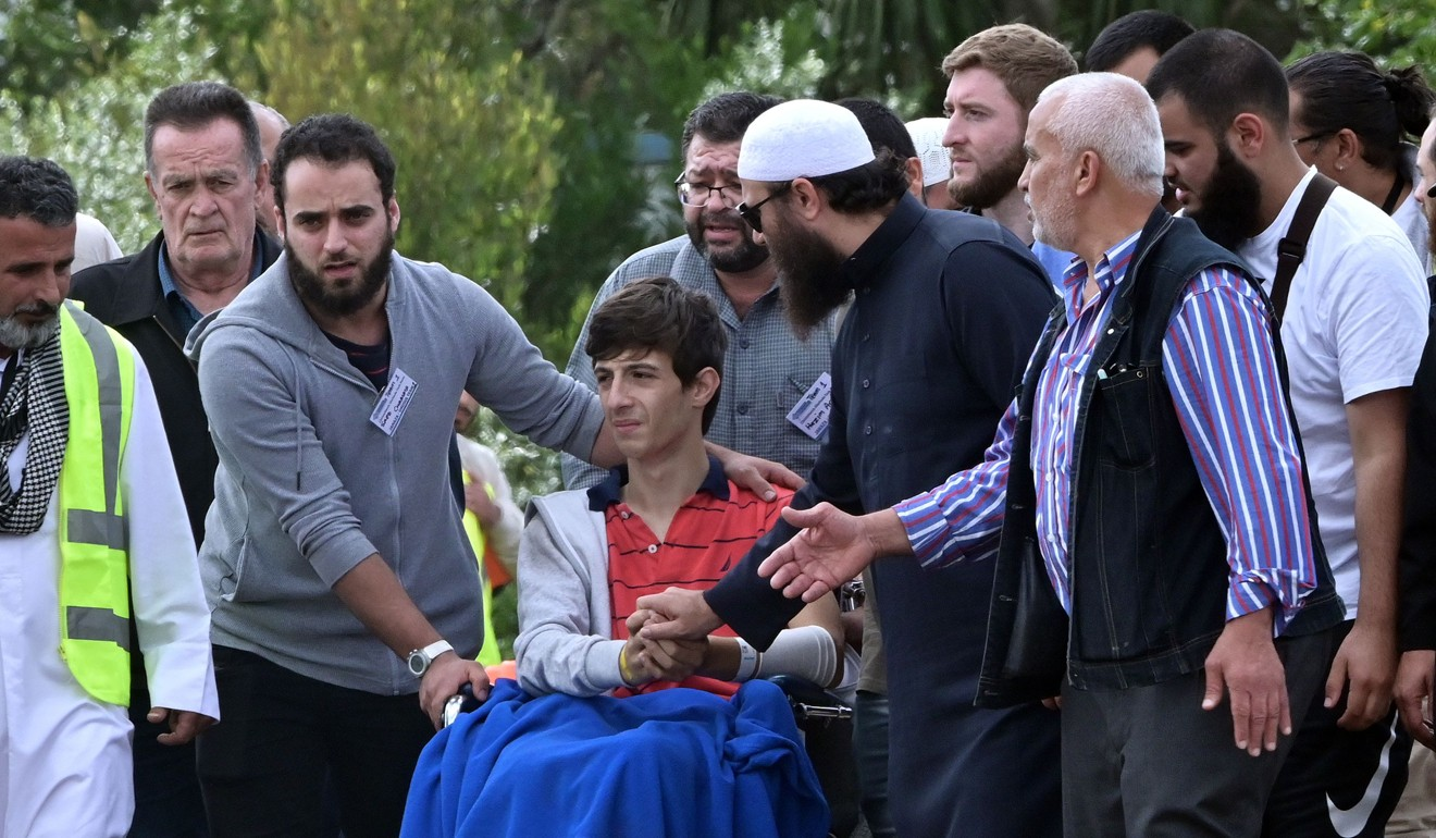 Zaid Mustafa (in wheelchair), who was wounded by an Australian white supremacist gunman, attends the funeral of his slain father Khalid Mustafa and brother Hamza Mustafa at the Memorial Park cemetery in Christchurch. Photo: AFP