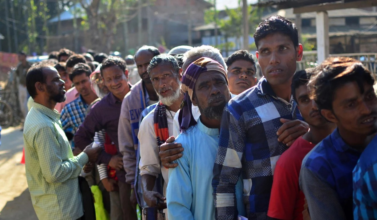 People queue to check their names on the first draft of the National Register of Citizens (NRC) in the Indian state of Assam. Photo: AFP