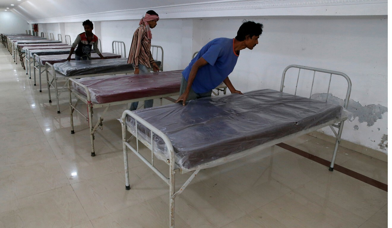 Workers prepare beds to set up a quarantine facility in Howrah on the outskirts of Kolkata. Photo: Reuters