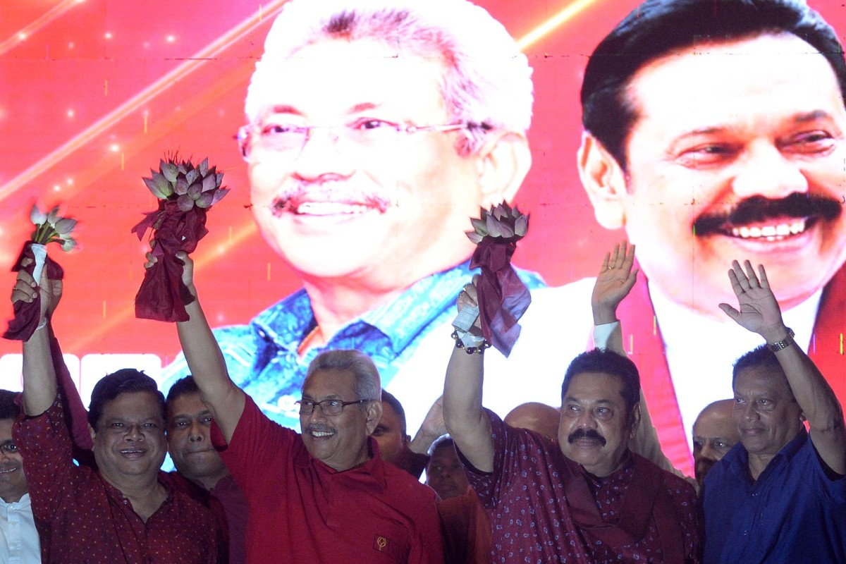 SLPP party presidential candidate Gotabhaya Rajapaksa (second from left) and his brother, former Sri Lanka's president Mahinda Rajapaksa (second from right) wave at supporters during a campaign rally in Homagama, Sri Lanka, on Wednesday. Photo: AFP