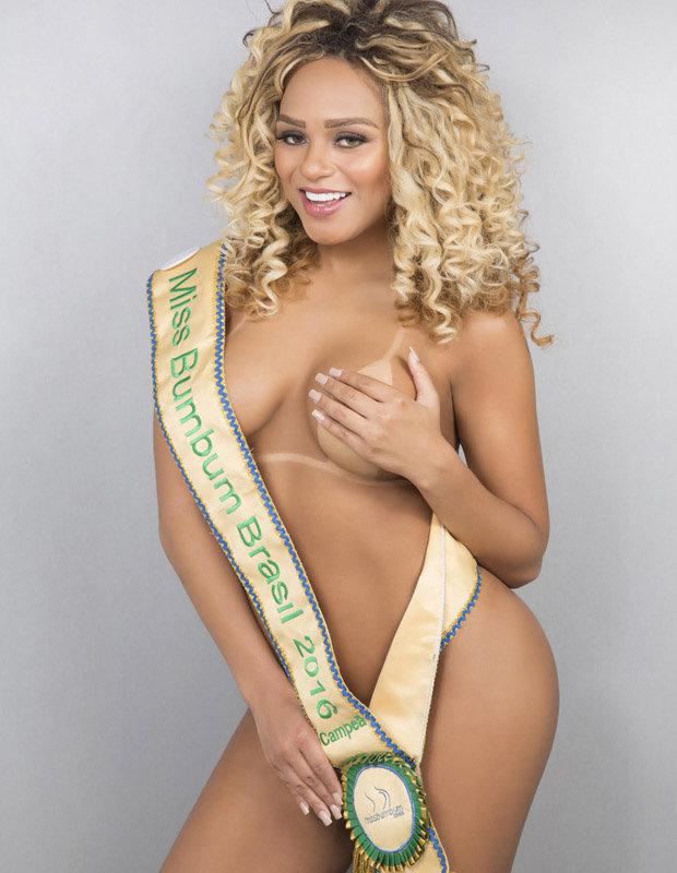 Erika Canela topless in sash
