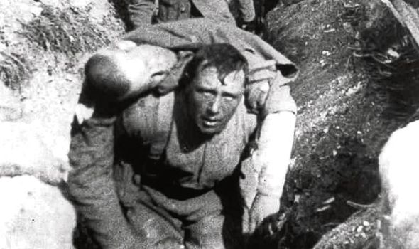 A British soldier carrying a wounded comrade in the trenches at the Battle of the Somme - a battle that left over a million soldiers dead