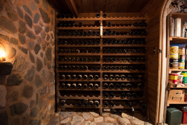 The wine cellar with redwood bottle rack I designed  -- magnums and sparkling on the bottom, 750's on top.