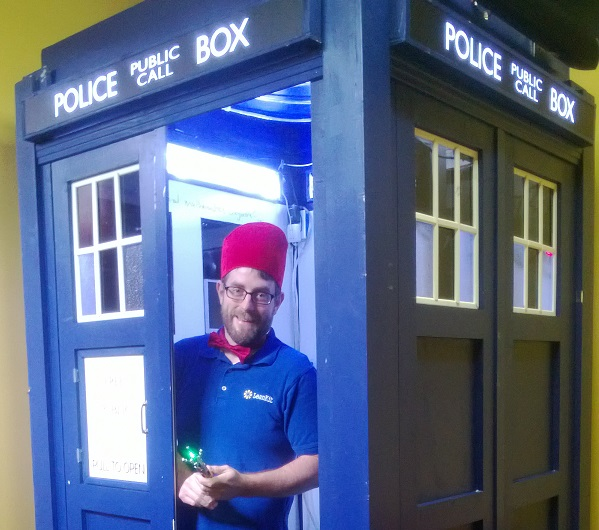 LeanKit CEO, Chris Hefley proudly shows off the employee-made TARDIS.
