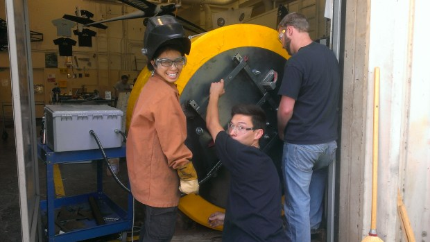 Teresa, Kevin and Tom working working on the buoy
