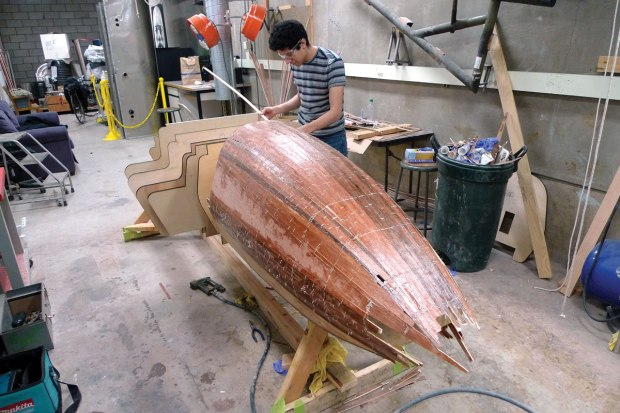 Using old fashioned boat-building techniques and laser-cut plywood cross sections, Alex Carrillo creates the plug for the race car body